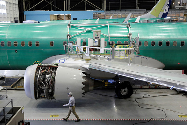 030 A worker walks past s Boeing 737 MAX 9 under construction at its production facility in Renton Washington.