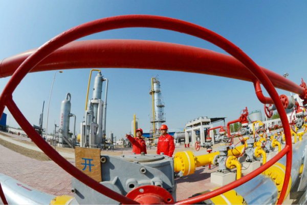 workers conduct a safety inspection on a natural gas transmission facility in April 2014 in Henan province