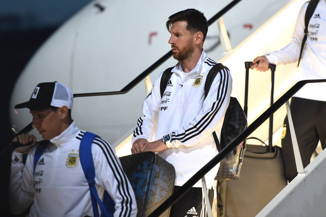 Argentinas forward Lionel Messi R disembarks from a plane at the Zhukovsky airport near Moscow as Argentinas national football team arrives ahead of the Russia 2018 World Cup