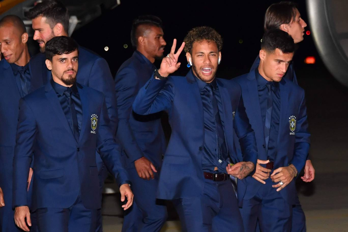 Brazils Fagner Neymar and Philippe Coutinho and the rest of the national team descend form the plan upon landing at Sochi airport in Russia