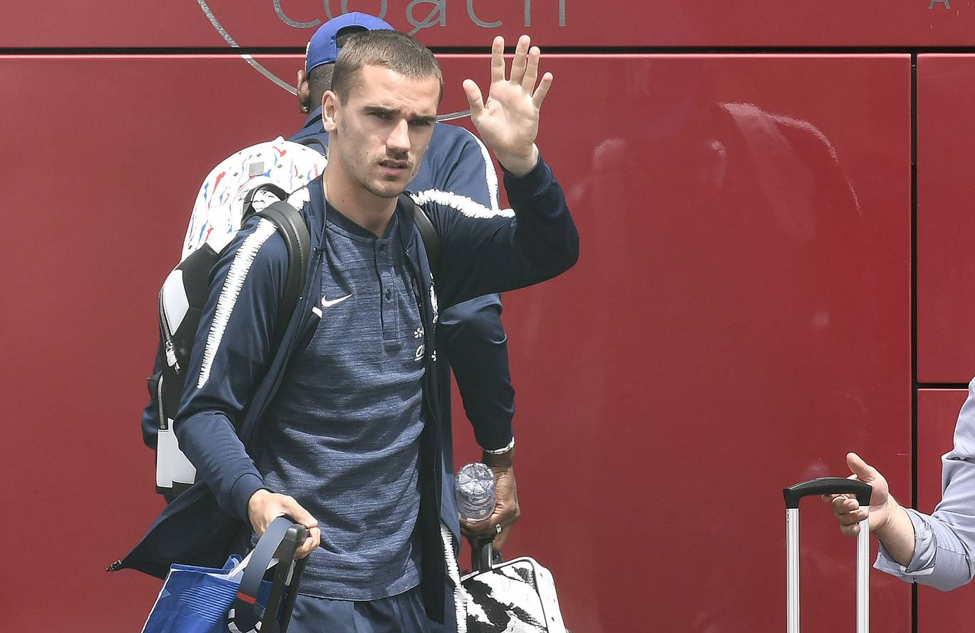 Frances forward Antoine Griezmann waves before taking a plane to Russia at the Brons airport near Lyon central eastern France