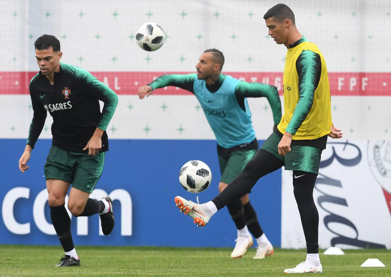 Portugals forwards Cristiano Ronaldo R and Ricardo Quaresma C and defender Pepe attend a training session at the teams base camp in Kratovo outskirts of Moscow