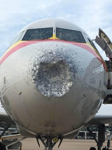 A view of the Tianjin Airlines passenger plane from flight A320 after it was hit by hail July 26 2018