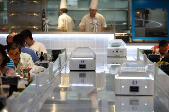 Robotic waiters at the Robot.He restaurant in Shanghai. The futuristic restaurant concept is the latest initiative in Chinese e commerce giant Alibabas push to modernise service and retai