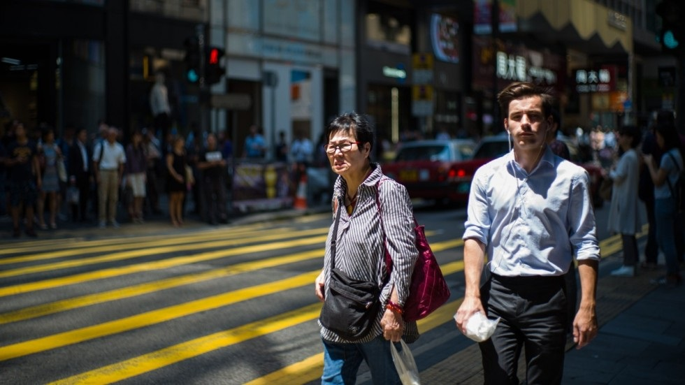 Hong Kongs high salaries come at a price with 50 of expatriates saying they work longer hours here