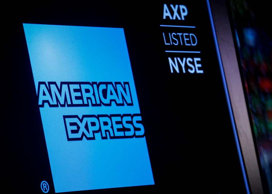 American Express logo and trading symbol are displayed on a screen at the New York Stock Exchange NYSE in New York