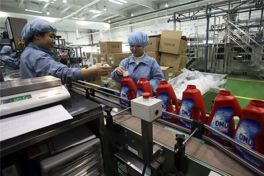 Employees of Unilever a London based daily necessities producer work at one of its facilities in Tianjin