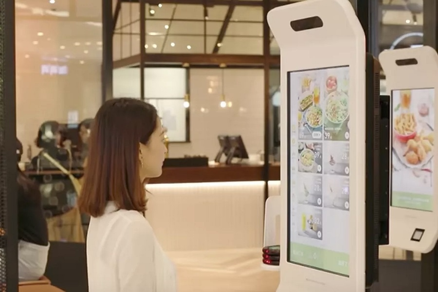 A customer tries Alipays facial recognition payment solution Smile to Pay at KFCs new KPRO restaurant in Hangzhou