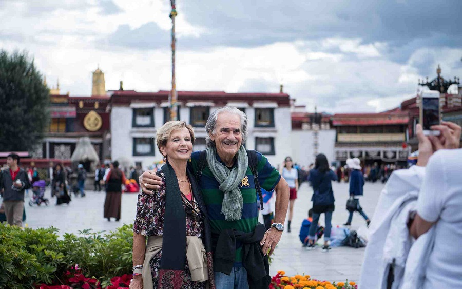 Foreign tourists take photos at Jokhang Temple in Lhasa capital of southwest Chinas Tibet Autonomous Region