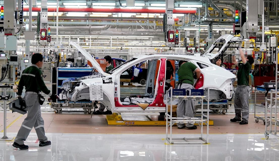Employees work at the production line of the Chery Jaguar Land Rover plant in Changshu