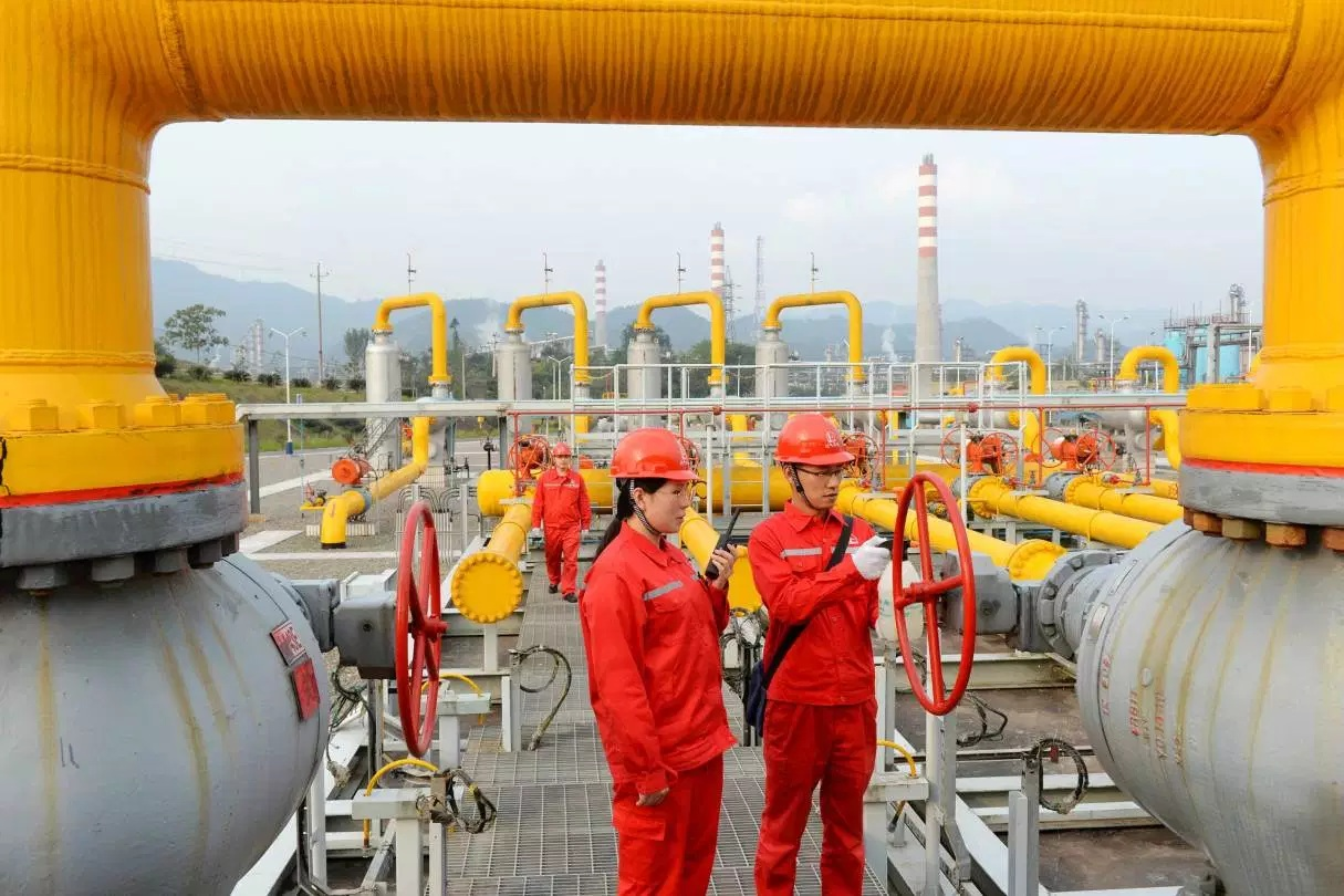 Workers inspect pipelines at a natural gas facility run by Sinopec in Dazhou Sichuan province China