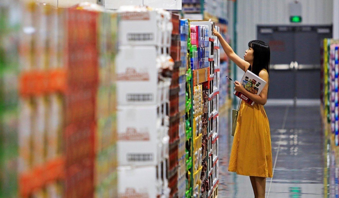 A staff member checks stocks ahead of the stores opening