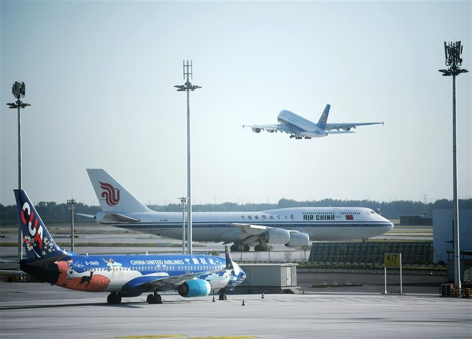 The A380 Superjumbo with China Southern Airlines takes off from the Daxing airport while the Boeing 747 with Air China and a Boeing 737 with China United Airlines are about to take off