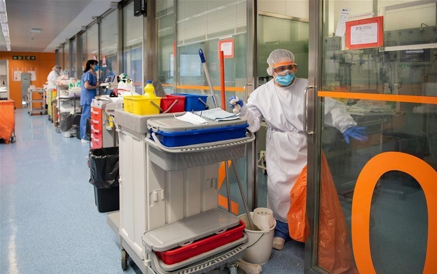 A staff member wearing protective gear cleans the COVID 19 ward at a hospital in Barcelona Spain on April 20 2020