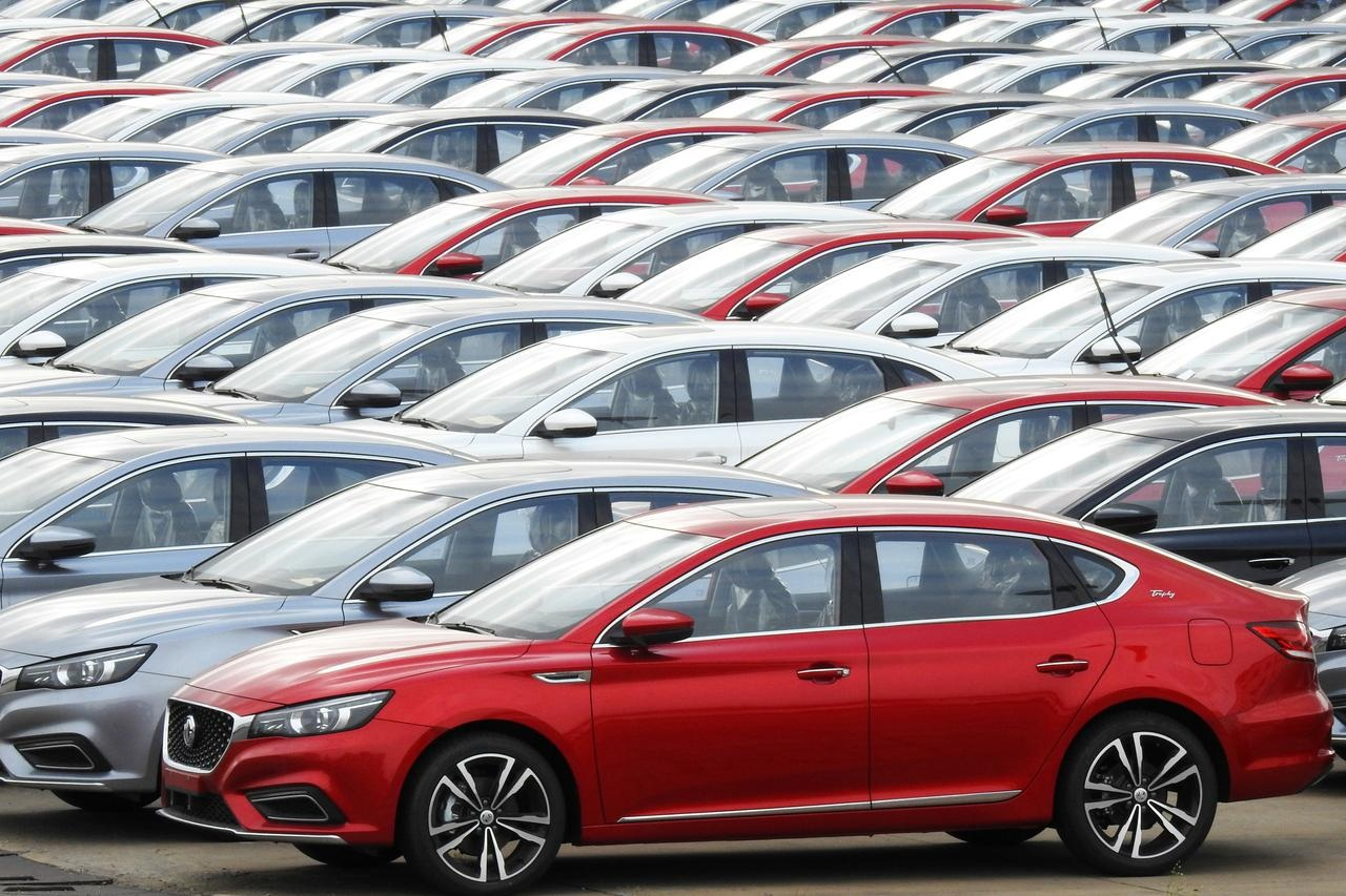 Cars for export wait to be loaded onto cargo vessels at a port in Lianyungang Jiangsu province