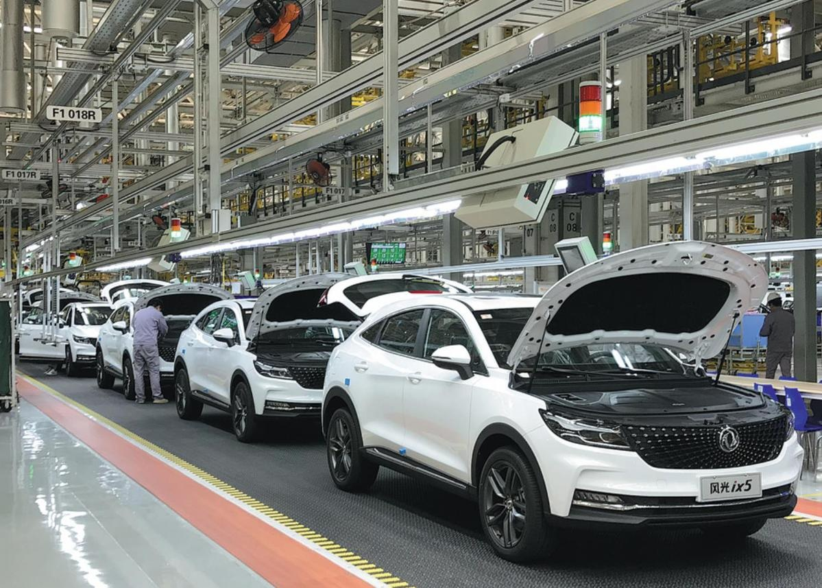 SUVs roll off the assembly line at a Dongfeng plant in Chongqing in April 2019