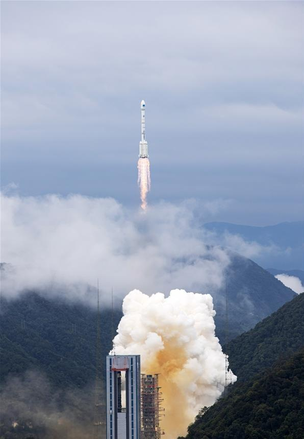 A carrier rocket carrying the last satellite of the BeiDou Navigation Satellite System blasts off from the Xichang Satellite Launch Center in southwest Chinas Sichuan Province on June 23