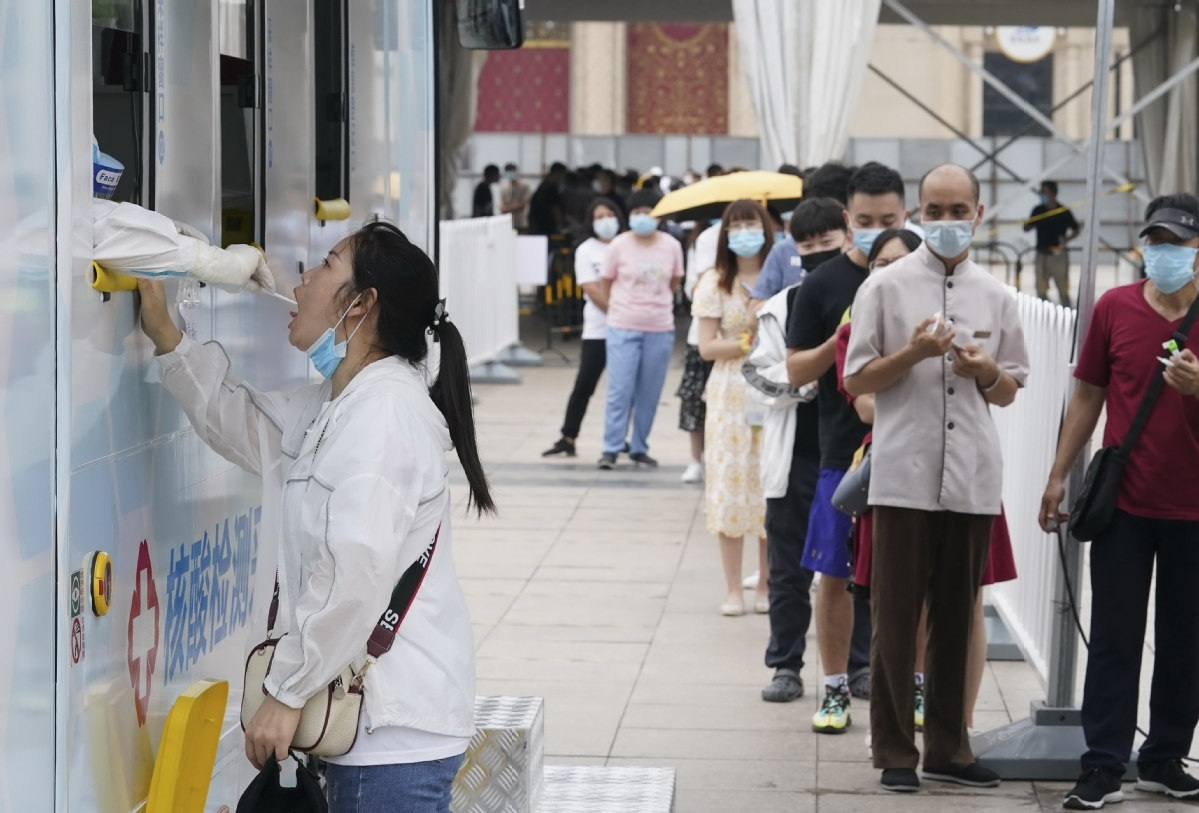 People wait to provide samples for nucleic acid tests for novel coronavirus in Beijing Copy