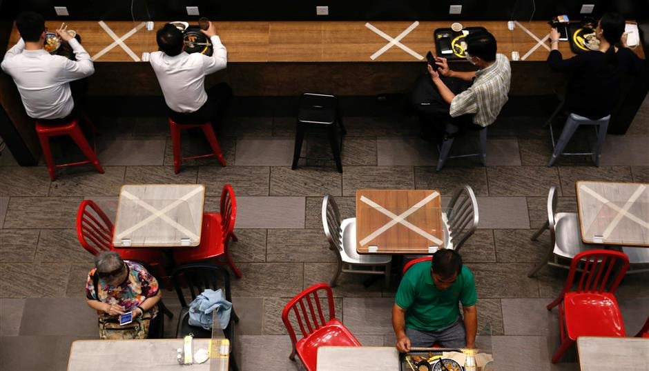 Social distancing marks are seen at a restaurant in Hong Kong