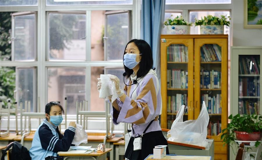 A teacher gives a lesson on the coronavirus epidemic prevention